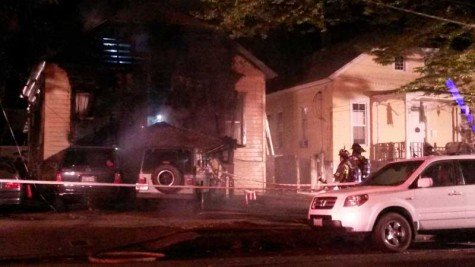 Students evacuate burning house