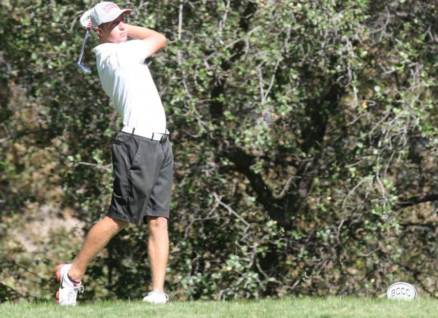Chico State golfer Alistair Docherty watches his shot. Photo credit: John Domogma