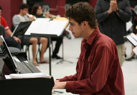 Daniel Michelson, junior mechanical engineering major, intently plays piano during the Jazz X-Press rehearsal Oct. 14 at the Performing Arts Center. Photo credit: John Domogma