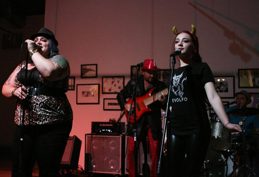 Christina Comfort, left, and Cat Perez of local funk-rock band Sofa King entertain concertgoers with their strong, jazzy vocals Tuesday at 1078 Gallery. Photo credit: John Domogma