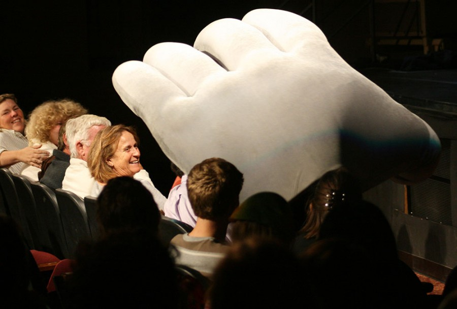 Audience members interact with one of the mimes of MUMMENSCHANZ, portraying a giant hand. The troupe performed a captivating theatrical show Tuesday night at Laxson Auditorium. Photo credit: John Domogma