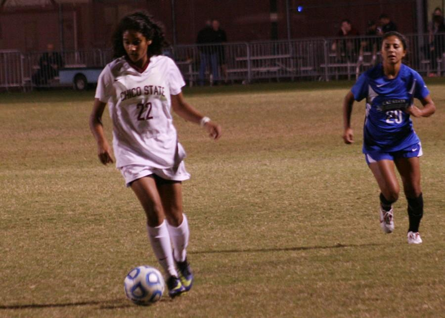 Chico State soccer player Pooja Patel takes the ball up the field in Thursday night's 3-2 win over Cal State San Bernardino. Photo credit: John Domogma