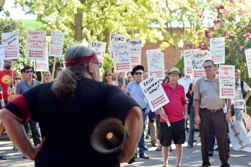 Political science professor Michael Coyle speaks to faculty members at the Chico State rally for contract negotiations. Photo credit: Ernesto Rivera