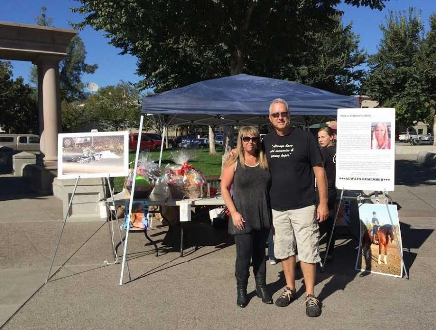 Sandra and Dave Chesterman gave away free reflector vests for the second annual Kristina Chesterman Memorial Bike Safety and Drunk Driving Awareness event, Sat. Oct. 18. Photo credit: Anna Sobreviñas