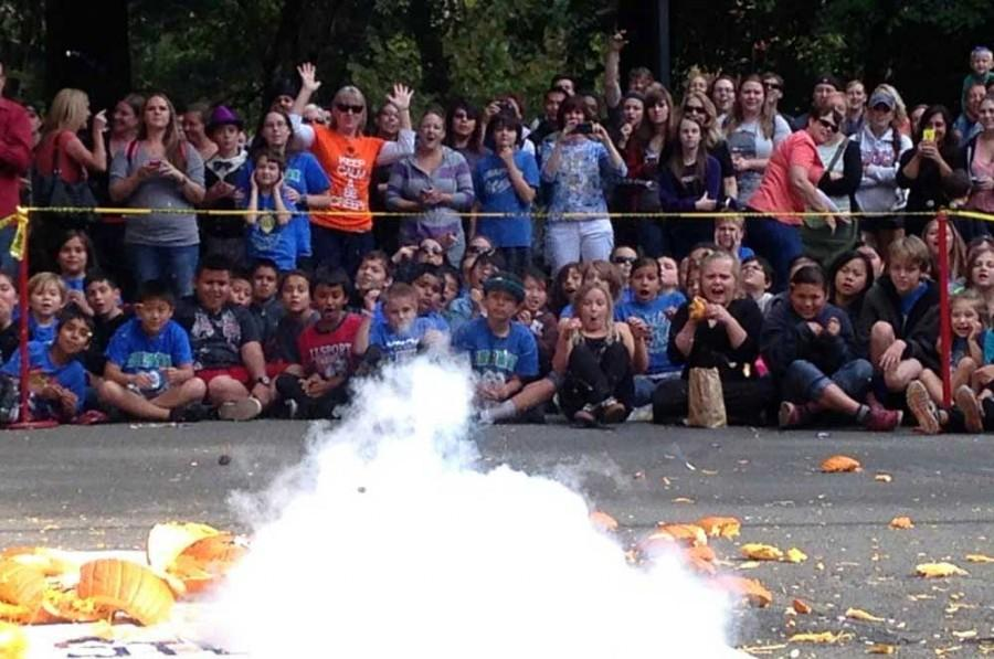 Kids from Chico elementary schools sit in front of Butte Hall for the 27th annual Pumpkin Drop. Photo credit: Christine Lee