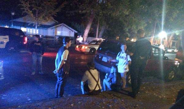 Out-of-towners talk to police after a fight on West Sixth and Ivy Streets Photo credit: Jovanna Garcia