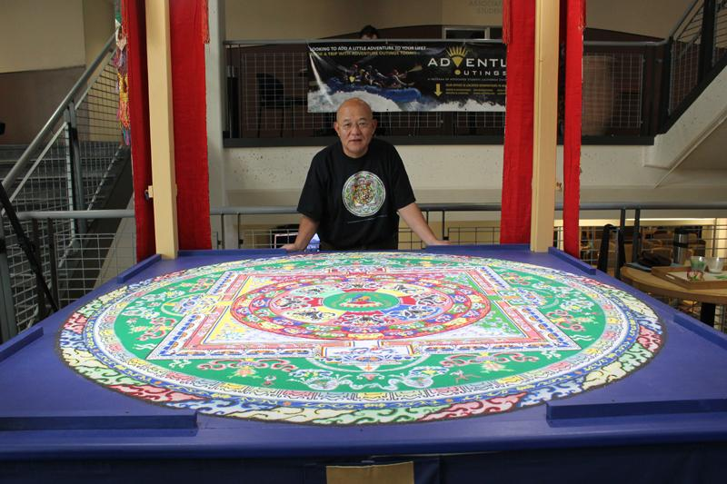 Losang Samten, Buddhist monk, has created three mandalas for Chico State, this being his last one. Photo credit: Lindsay Pincus