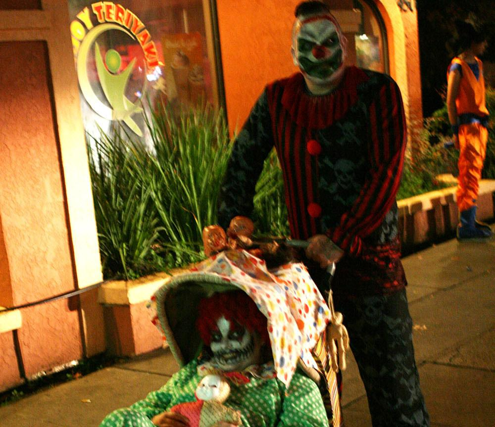 Adam Berry and Jessica Garland, locals of Chico take to the streets in their killer clown costumes on Halloween night 2014. Photo by John Domogma.