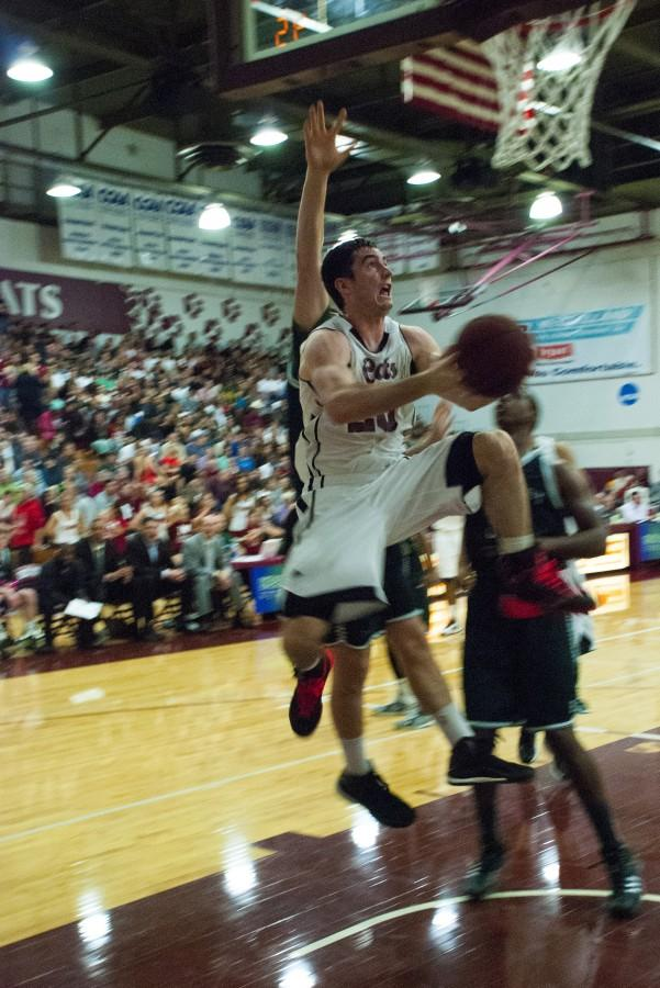 Chico State mens basketball player Sean Park gets airborne in a game last season. Orion file photo