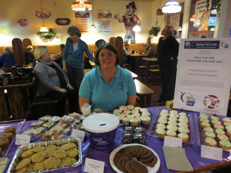 Lori Adrian, a political science department staff member, with yummy bake sale items at Mountain Mike's Pizza. Photo credit: Taylor Sinclair