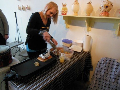 Molly Rzepecki makes pulled pork sandwiches at 1078 Gallery for its December Mixed Media Mixer event Sunday. Photo credit: Christina Saschin