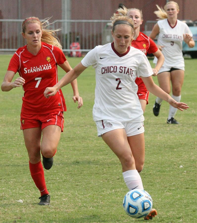 Cassi Scroggins competes against a Cal State Stanislaus opponent in a game earlier this season. Photo credit: John Domogma