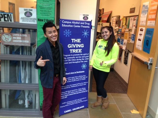CADEC interns, Aaron Thao and Jazmine De La Cruz, support the Giving Tree project. Photo credit: Amanda Rhine