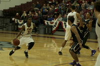 Point Guard Jalen McFerren getting ready to attack against a San Francisco State defender Photo credit: Gustavo Ornelas