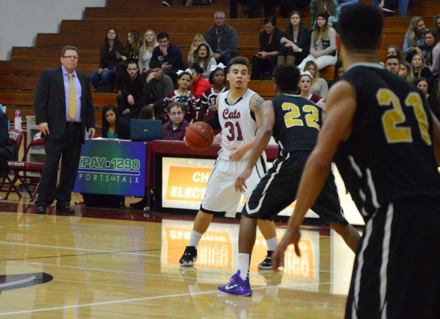 Chico State's Mike Rosaroso (31) facing the defense from San Francisco State's Derrick Brown (22) on Jan 16. Photo credit: Caio Calado