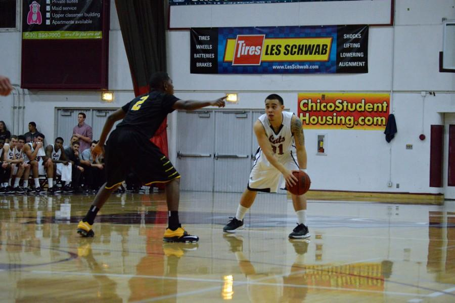 Chico State's Mike Rosaroso being guarded by Los Angeles State's Chris Martin on Jan 30. Photo credit: Caio Calado