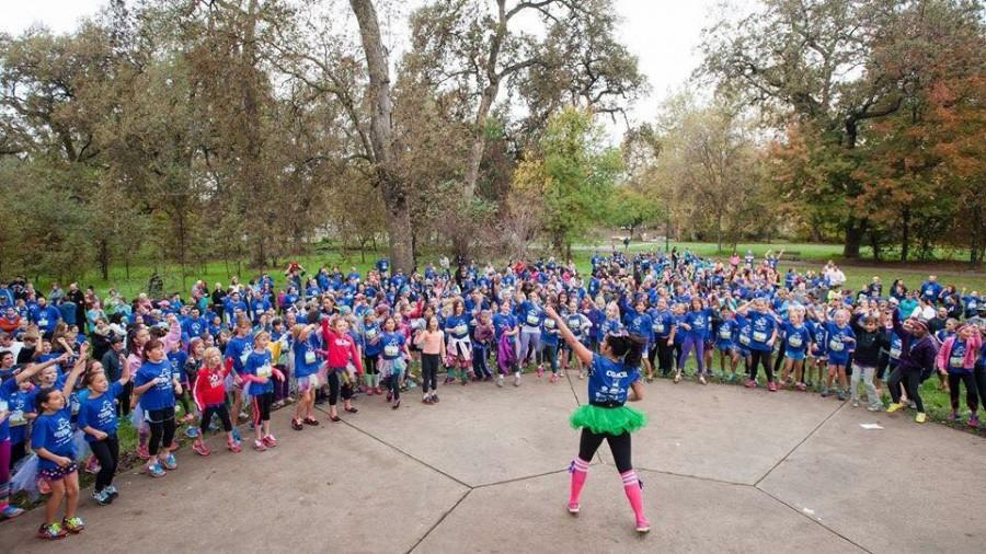 Brittany Kissinger, Chico State Alumn, warms up the crowd for Girls on the Run with her zumba dance moves.