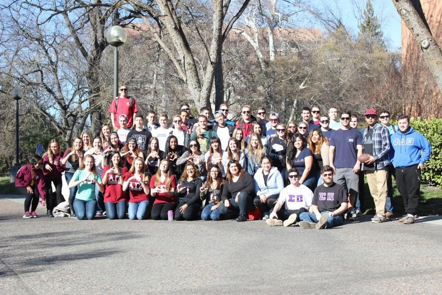 Fraternities and sororities gather in the breezeway on campus to promote rush week. Photo credit: John Domogma