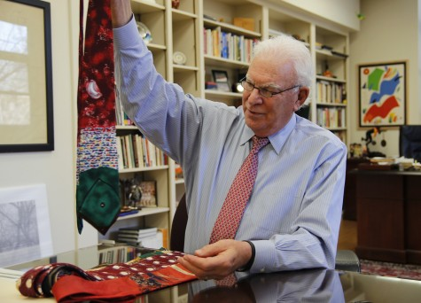 Chico State President Paul Zingg holds up one of the many ties from his extensive collection. Zingg has been president of the university since 2004. Photo credit: Malik Payton
