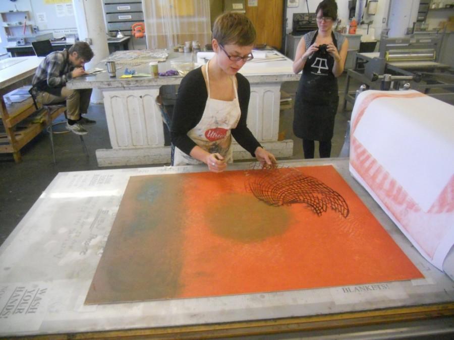 Artist Monika Meler assembles artwork for her exhibition