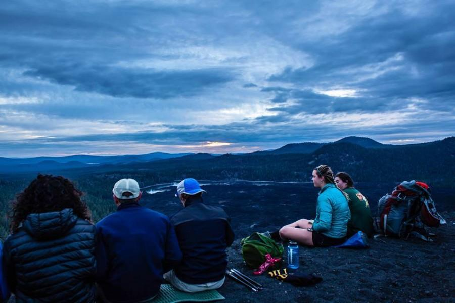 Melissa Berndt and her group take a moment to rest during Wildcat Wilderness Orientation on top of the cinder cone volcano in Lassen National Park. After going on many trips through Adventure Outings as a participant, Berndt is now a trip leader who guides others. Photo courtesy of Melissa Berndt.