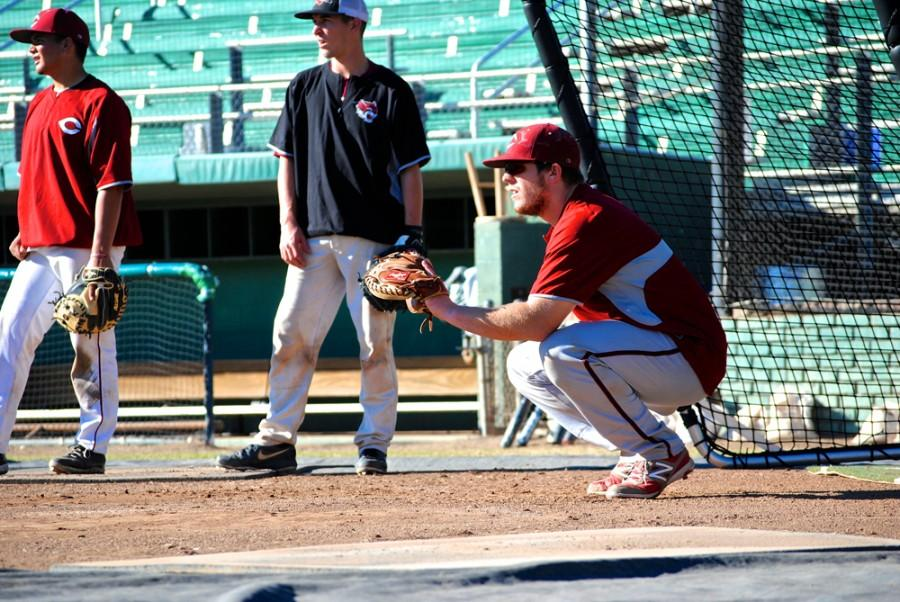 Peter Miller, catcher for the Chico State baseball team, practices for an upcoming coming game. Millers efforts helped the Wildcats achieve the conference lead in least amount of stolen bases last season. Photo credit: Zach Aucella