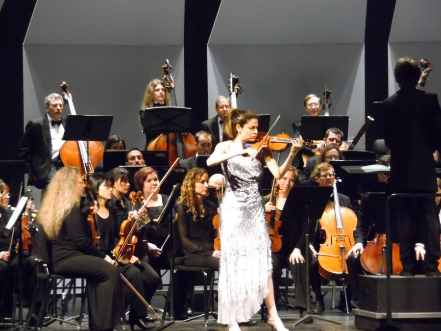 Lindsay Duestch leading beautifly The North State Symphony in a violin solo. Photo credit: George Johnston
