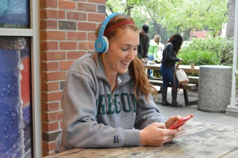 Brooke Bowen, forward on the women's basketball team, listens to her favorite song,