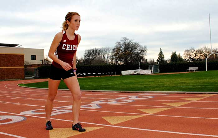 Julie Finn, junior on Chico State's cross-country and track and field teams, sets up to practice for the 1500-meter event. The spring semester means a change in landscape for competitors as races and events move to the track. Photo credit: Zach Aucella