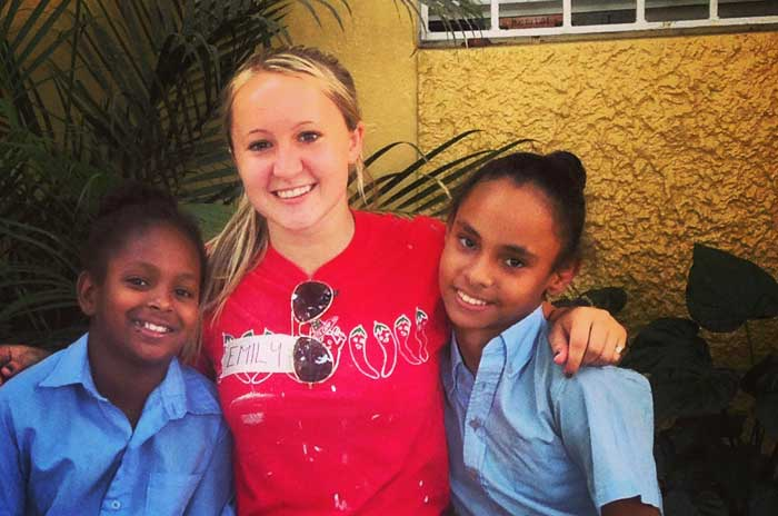 Emily Hilbers, a sophomore business management major, volunteers in the Dominican Republic during a summer trip. During those four weeks she spent time repairing homes and teaching local schoolchildren. Photo courtesy of Emily Hilbers.