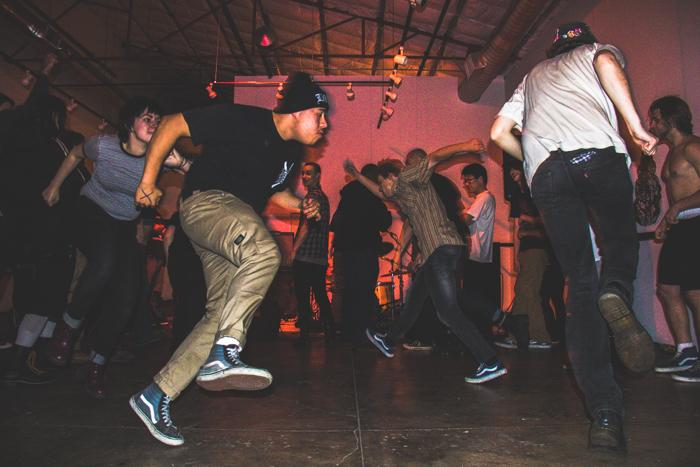 A circle pit gets going at the Jefferson Fest Showcase during PSO's performance at the 1078 Gallery, Feb. 27, 2015. Photo credit: Trevor Ryan