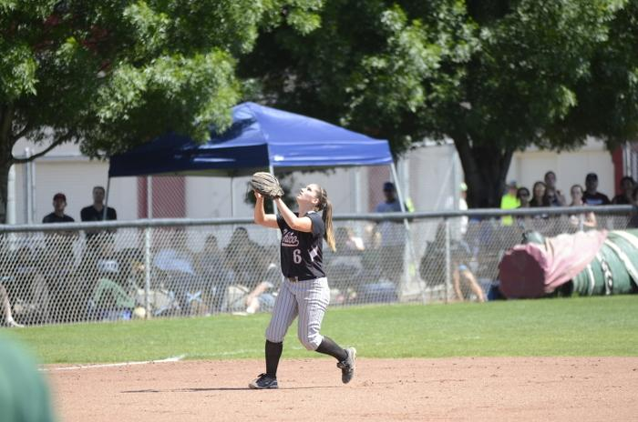 Senior infielder Emily McEnaney attempting to catch a fly ball against Humboldt State on April 17. Photo credit: Ryan Pressey