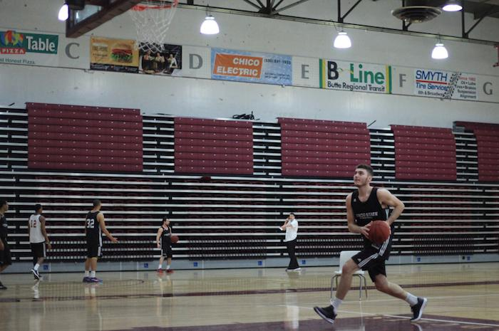 First-year guard Corey Silverstrom goes up for a layup during practice this past season. Photo Credit: John Domogma