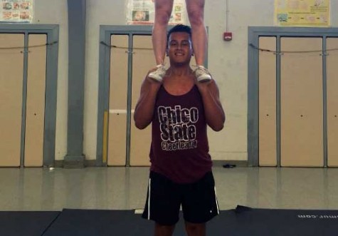 Male Wildcat cheerleader keeps squad flying high