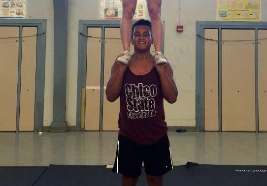 Male Wildcat cheerleader keeps squad flying high