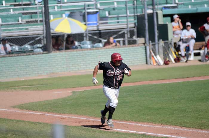Senior third baseman Dylan Garcia runs to first base during a game against Cal State Dominguez Hills on April 11. Photo credit: Ryan Pressey