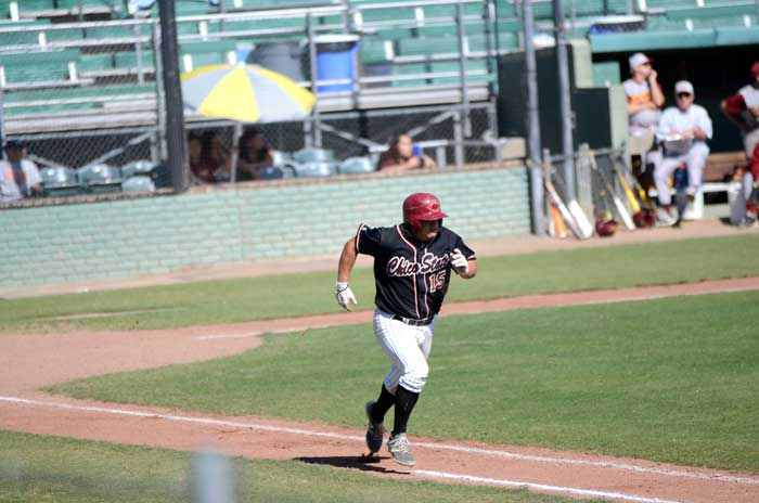 Senior third baseman Dylan Garcia runs toward first base on April 11 in a game against Cal State Dominguez Hills. Photo credit: Ryan Pressey