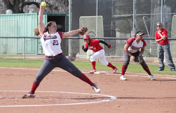 Freshman pitcher Haley Gilham launches the ball at the Chico State softball field in a game against University of Hawaii on Feb 12. Photo Credit: John Domogma