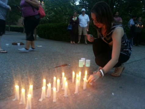 Chico State third year Sylvia Dorghalli places her candle to spell out Nepal outside of Siskiyou Hall