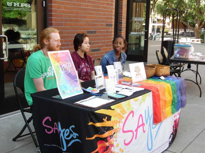 Chico State students Travis McNiff, left, Guadalupe Gomez and Alexis Green table at the