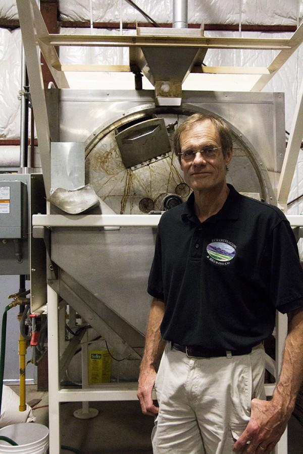 Jim Eckert stands next to the tank that holds his gluten-free beer. Photo credit: Jenelle Kapellas