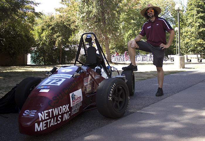 Sam Rabellino, senior mechatronics engineering major, explains what his club, Formula SAE, does. Photo credit: Christine Zuniga