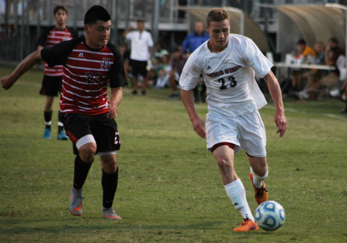 Matt Hurlow, senior forward, dribbles the ball up the field. Photo credit: John Domogma