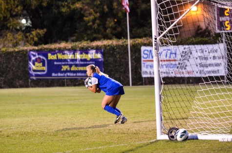 First-year student Mackenzie Boulton cradles the ball and scopes out her next move. Photo credit: Ryan Pressey