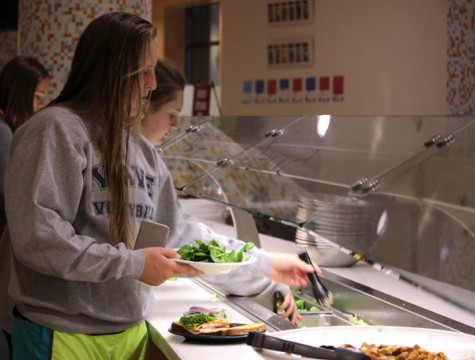 First-year animal science major, Delaney Friel, gets salad from the Sutter Dining Hall self-serve bar. Photo credit: Christine Zuniga