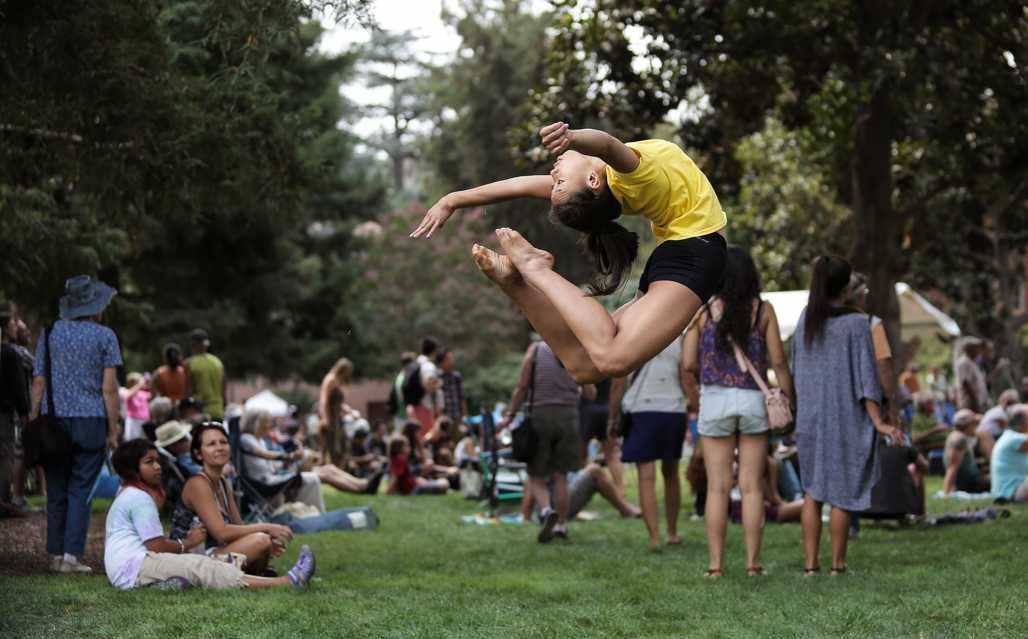 Kimly Lewis, 15, performs a ring flip in front of Kendall Hall during Chico World Music Festival.