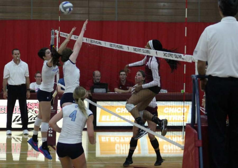 Janai Johnson, junior, smashes the ball back over the net for the Wildcats. Photo credit: John Domogma