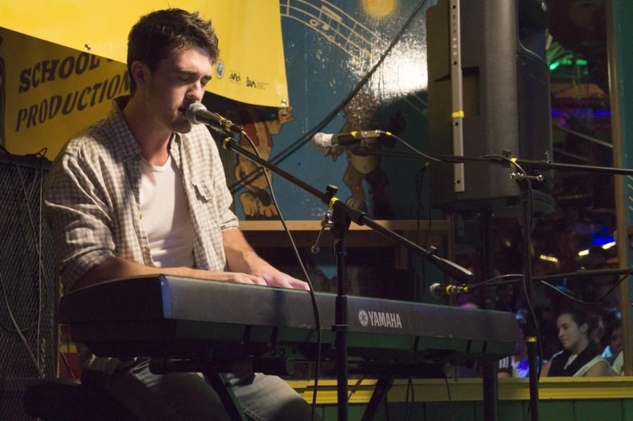 Senior Brady Shaw plays the piano during Thursday's Chico Unplugged performance at Madison Bear Garden. Photo credit: Grant Casey