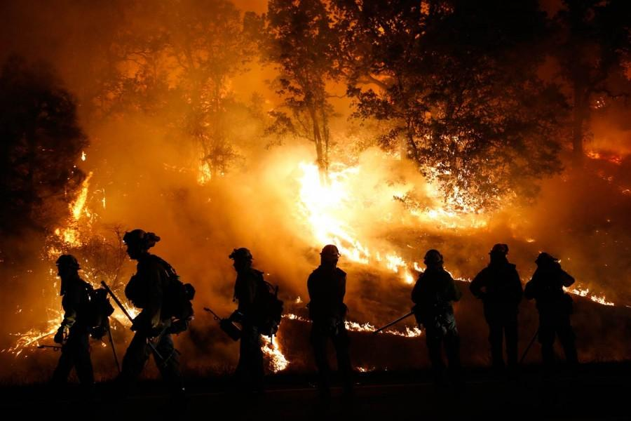 Multiple fire fighters flee to the hills of destruction caused by the Valley fire. Photo courtesy of NBC.