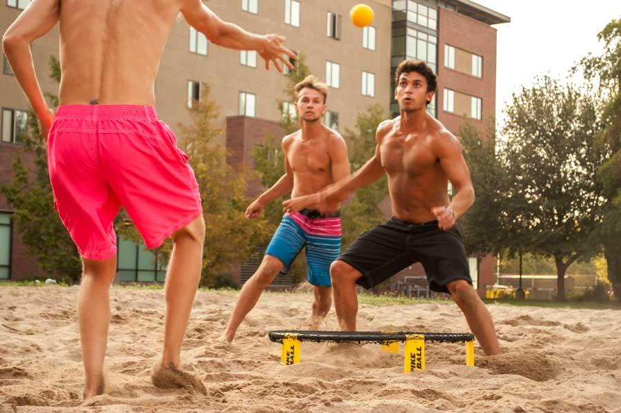 Preston Bies, Tom Whitt and Taylor Johnson in the middle of an intense Spikeball match on the volleyball court between Shasta and Lassen Halls. Photo credit: Sam Barker